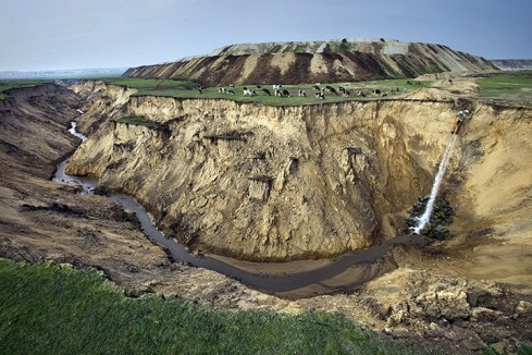 The water-energy ravine is here manifested in this image as a drainage pipe at the Baorixile coal mine in Inner Mongolia. (Image courtesy of Greenpeace)